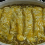 Shredded Pork Enchiladas, Mexican Rice, and Refried Beans
