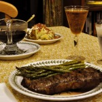 Grilled New York Strip Steaks with Pinot Noir Reduction Sauce, Baked Potatoes, and Grilled Asparagus