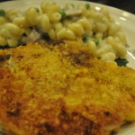 Veal Milanese and Cellentani with Parmesan Bechamel Sauce, Ham, Mushrooms, and Peas